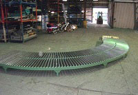 gravity conveyor bend for use with a conveyor system