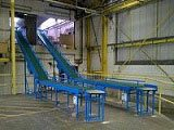 Mezzanine inter-floor conveyors for loading bay
