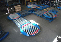Pallet handling system with turntables and scissor lift tables