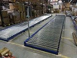 Motorised conveyor, chain driven