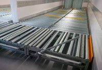 Pallet handling system for temperature controlled unit