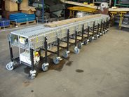 Power roller expandable conveyor